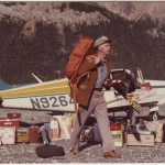 "Photo of Walter ""Yukon"" Yates with his plane in Post River, Alaska, dated July 3, 1975."