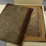 After the leather is consolidated, the original cover of the book is housed with the book in the same box.
