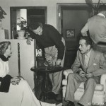 """Nicholas Ray, center, with Gloria Grahame and Humphrey Bogart on the set of """"In a Lonely Place"""" (1950)."""