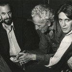 """Rip Torn, Nicholas Ray, and Marilyn Chambers discussing Ray's film project, """"City Blues,"""" ca. 1976."""