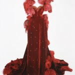 Photo of burgandy ball gown before conservation project.