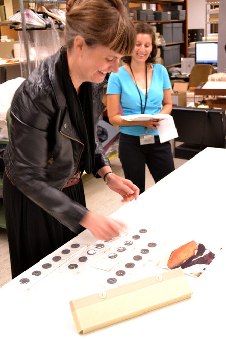 Jill Morena, collection assistant for costumes and personal effects, explains how each weight is documented with its original location on the dress.