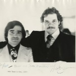 "A photograph of Paul Schrader and director Martin Scorsese, with Scorsese's inscription: ""From one Travis to another."" Schrader wrote the screenplay for and Scorsese directed ""Taxi Driver"" (1976)."