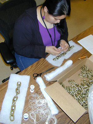 "Samantha Cabrera constructing ""book snakes"" with chain links. Photo by Mary Baughman."