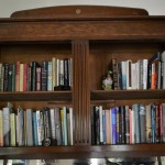 Campbell keeps a shelf of books written by the scholars who have stayed with her. Photo by Alicia Dietrich.