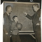 "Clair Bree (left) and Howard Cann diagram play for a basketball clinic. ""New York Journal-American,"" December 12, 1948."