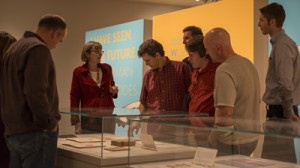 """Employees from Dell visit the exhibition """"I Have Seen the Future: Norman Bel Geddes Designs America."""" Photo by Pete Smith."""