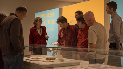 "Employees from Dell visit the exhibition ""I Have Seen the Future: Norman Bel Geddes Designs America."" Photo by Pete Smith."