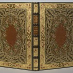 """Cover of Percy Shelley's poem """"The Sensitive Plant"""" bound by Sangorski & Sutcliffe. The text is handwritten on parchment by Alberto Sangorski, with decorative borders and illuminated miniatures. Photo by Pete Smith."""