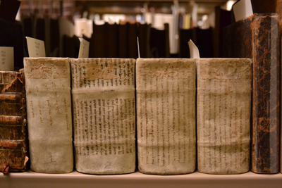 These four volumes of German poetry are wrapped in manuscript waste materials written in Hebrew. Photo By Alicia Dietrich.