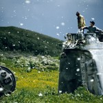 "Jonas Bendiksen. ""Russia. Altai Territory. Villagers collecting scrap from a crashed spacecraft, surrounded by thousands of white butterflies. Environmentalists fear for the region's future due to the toxic rocket fuel."" 2000 © Jonas Bendiksen/Magnum Photos."