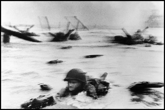 """France. Normandy. Landing of the American troops on Omaha Beach."" 1944 © Robert Capa © International Center of Photography/Magnum Photos"
