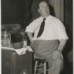 """A 'take' with Tea"" publicity still of Hitchcock making his tea on the set of ""Rebecca."""