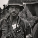 "David Douglas Duncan. ""Captain Ike Fenton, Commanding Officer of Baker Company, 1st Battalion, 5th Marine Regiment, 1st Provisional Marine Brigade, receives reports of dwindling supplies during the battle to secure No-Name Ridge along the Naktong River, Korea,"" September 1950. Gelatin silver print."