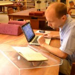 Dariusz Pachocki studies the Lesiman papers in the Ransom Center's reading room. Photo by Alicia Dietrich.