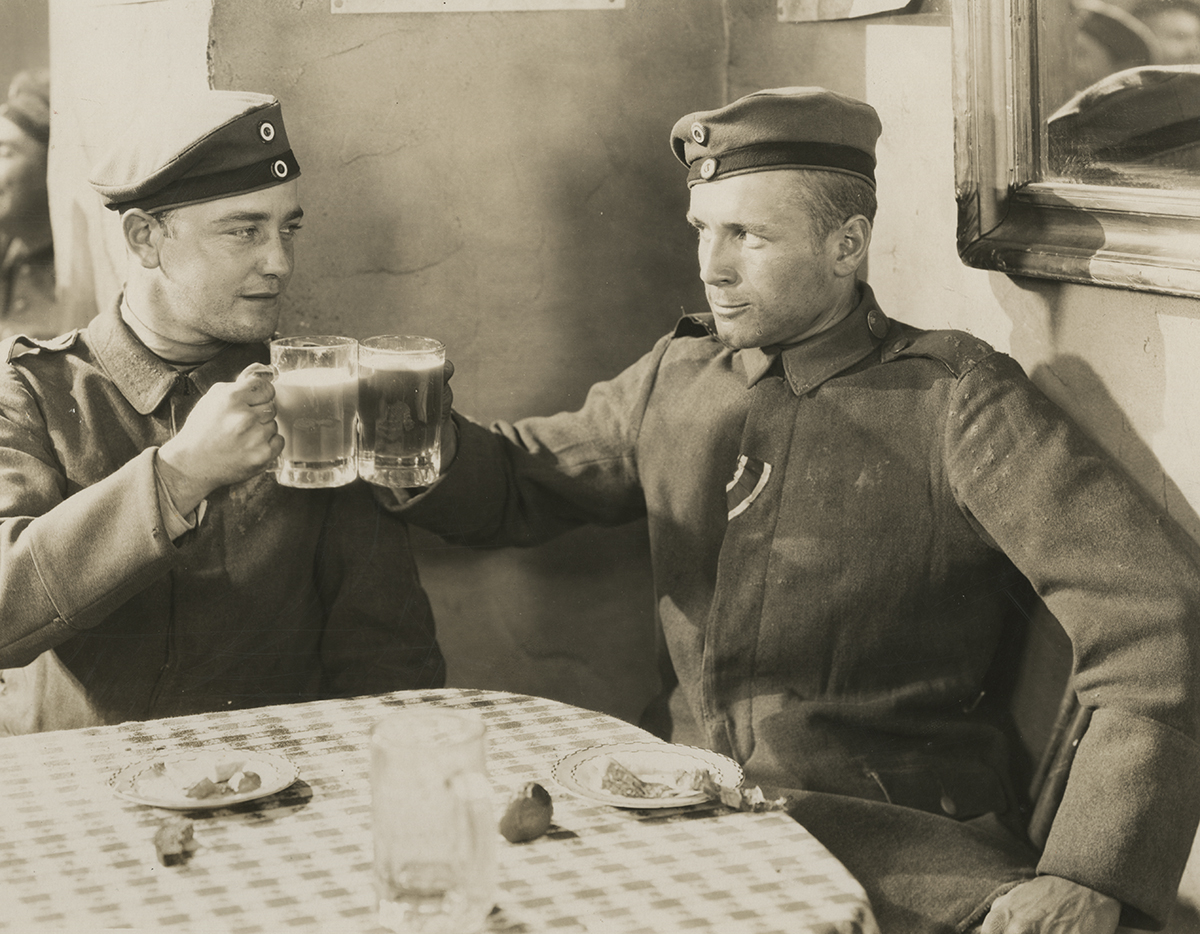 "German soldiers enjoy a brief respite from trench duty in a film still from ""All Quiet on the Western Front."""