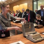 Jean Cannon sharing collection materials, including Anne Sexton's typewriter, with Ransom Center members.