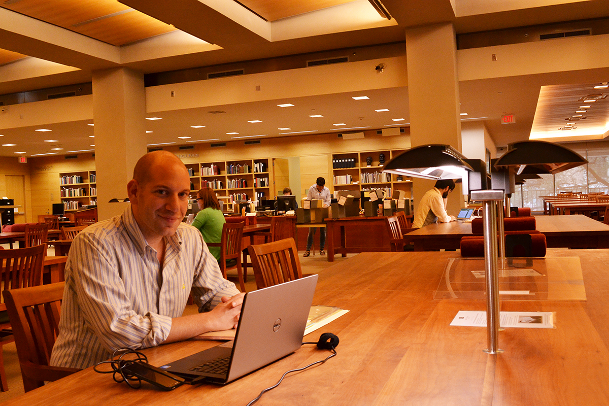 Alex Feldman in the Ransom Center's reading room. Photo by Alicia Dietrich.