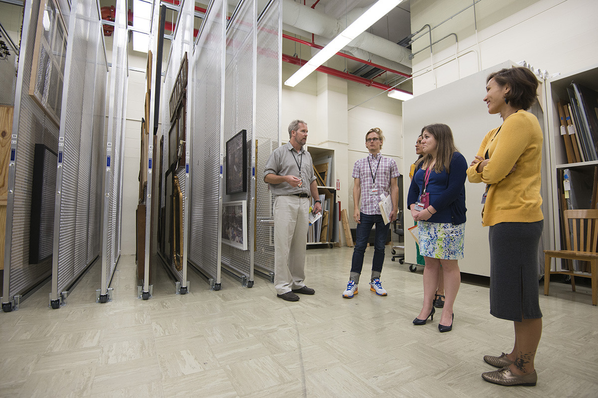 Watson leads a tour of new graduate interns through the Ransom Center's vertical storage space for art. Photo by Pete Smith.