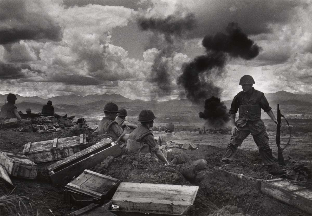 "David Douglas Duncan. ""From the heights of Con Thien, the U.S. Marines of Mike Company look down upon the DMZ during daily fighter-bomber attacks on the enemy."" Vietnam, September/October 1967."