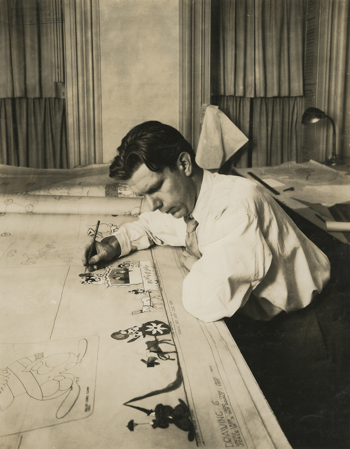 Norman Bel Geddes draws a concept for a Macy's Thanksgiving Day parade float, ca. 1926. Unidentified photographer.