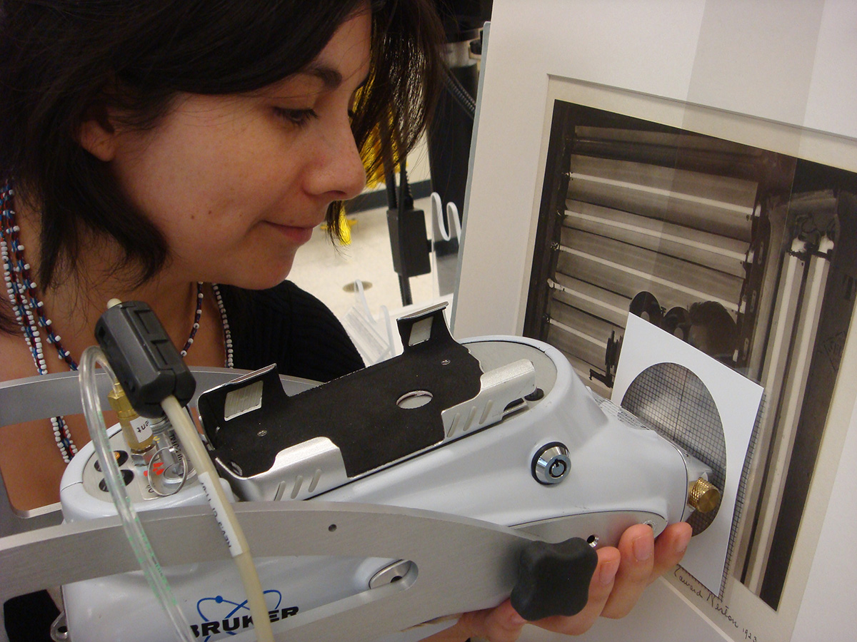 Diaz performing XRF Scientific Analysis on a photograph at the Amon Carter Museum of American Art, Fort Worth, TX. Photo by Sylvie Pénichon.