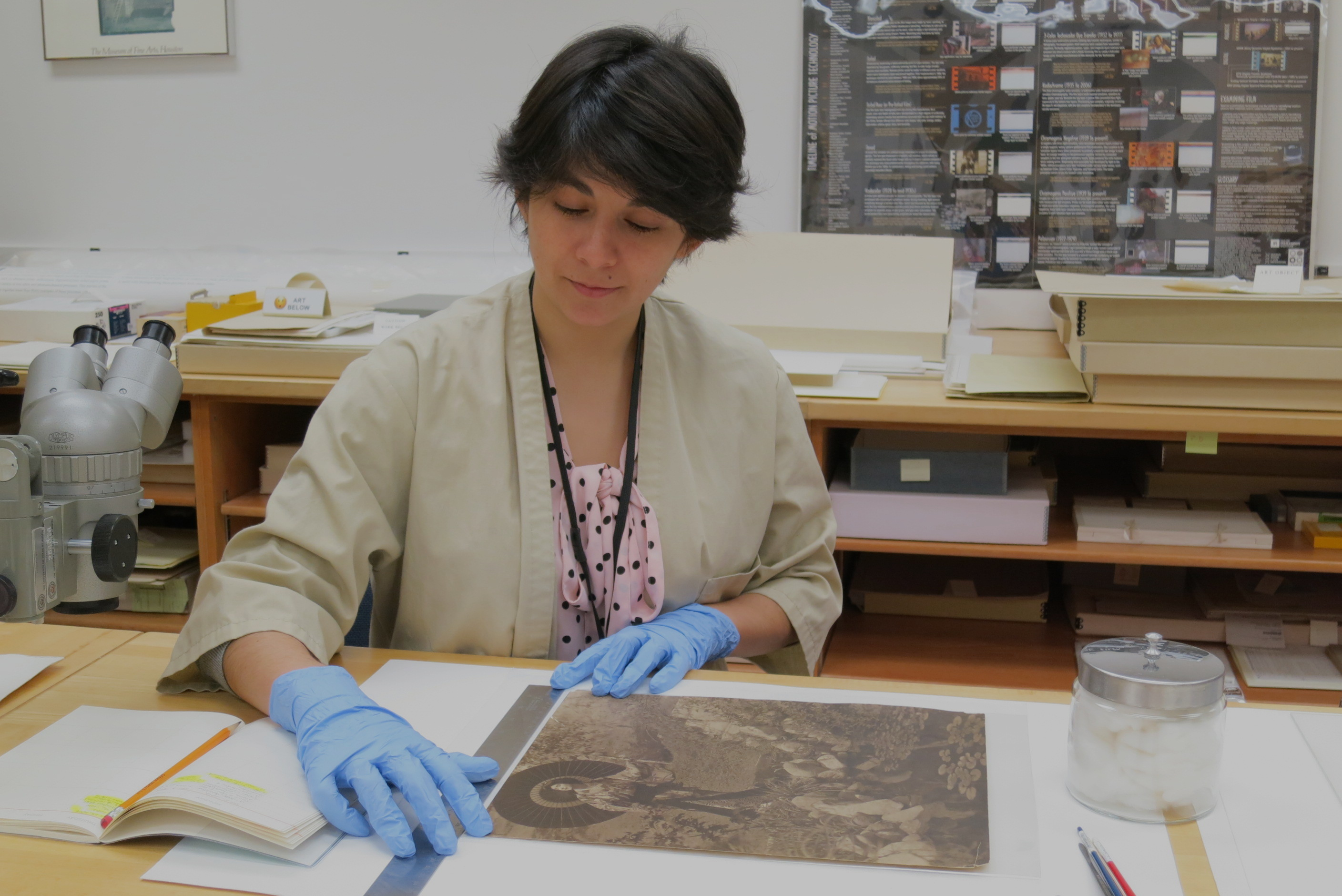 Diaz works on a treatment in the photography conservation lab at the Ransom Center. Photo by Jane Boyd and Barbara Brown.