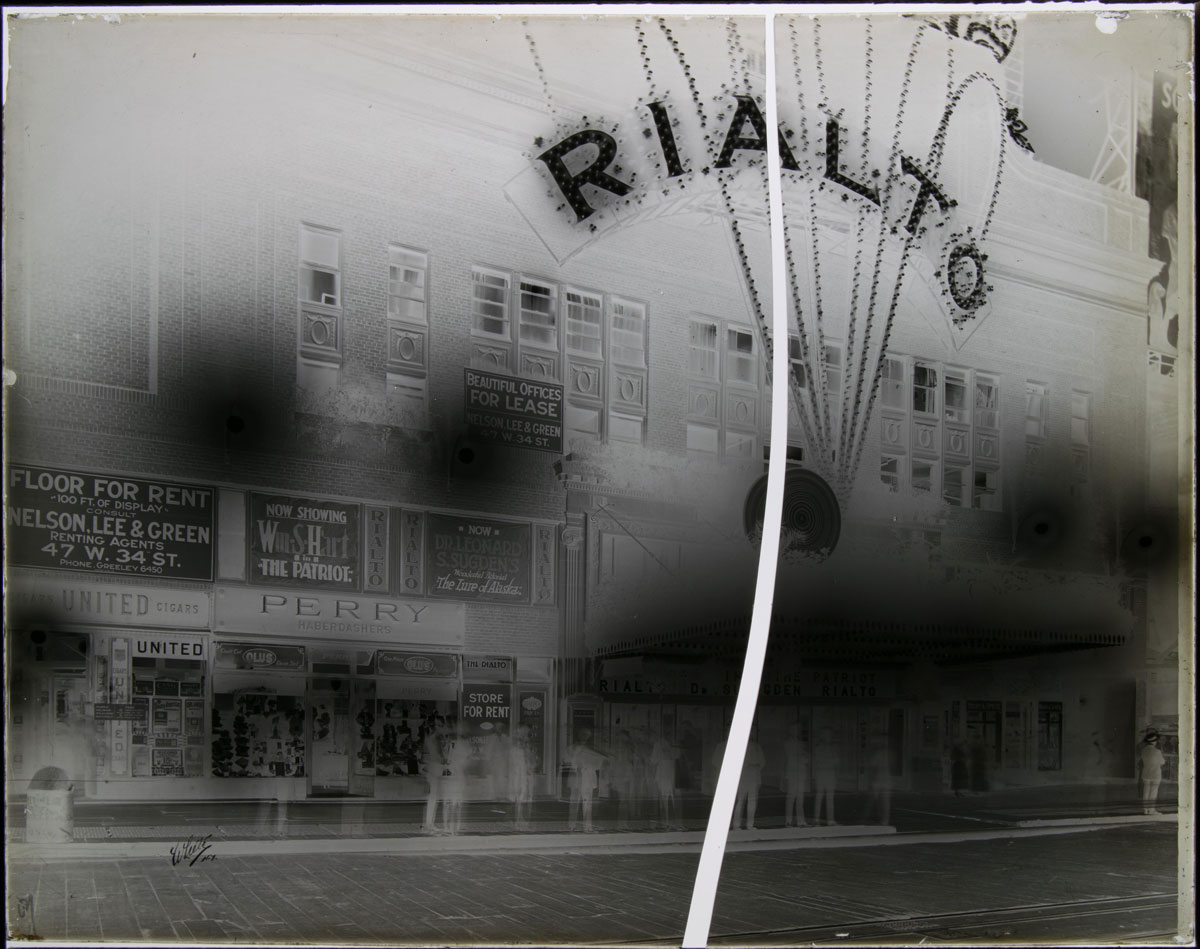 The glass plate negative of the Rialto Theater before treatment, broken into two pieces.