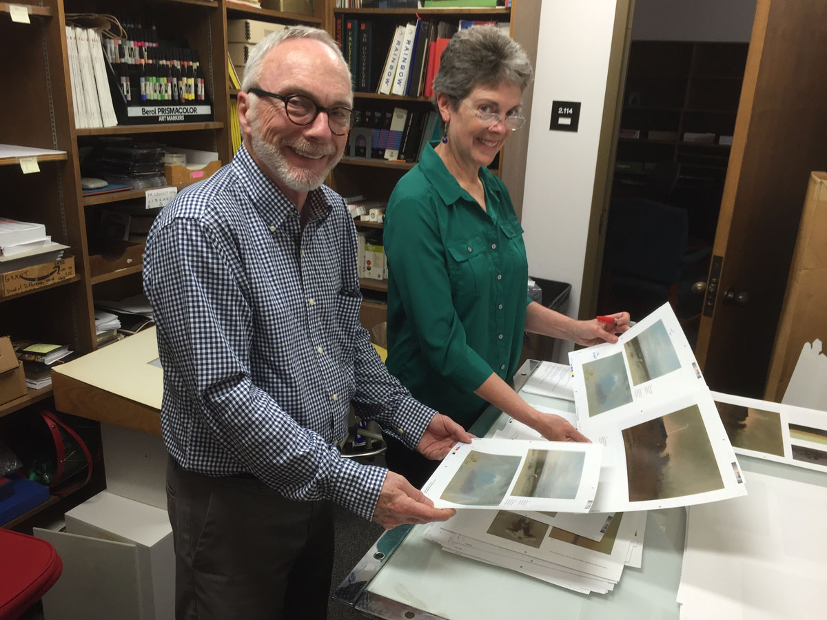 Peter Mears checking color match prints for the Reaugh book, Windows on the West, with Ellen McKie at UT Press.