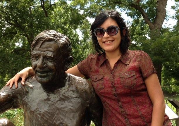 """Daniela Lozano hanging out with J. Frank Dobie at """"Philosophers' Rock"""" at Zilker Park. Photo by Joan Sibley. Daniela Lozano pasando el tiempo con J. Frank Dobie en """"La Piedra de los Filósofos"""" en Zilker Park. Fotografía por Joan Sibley."""