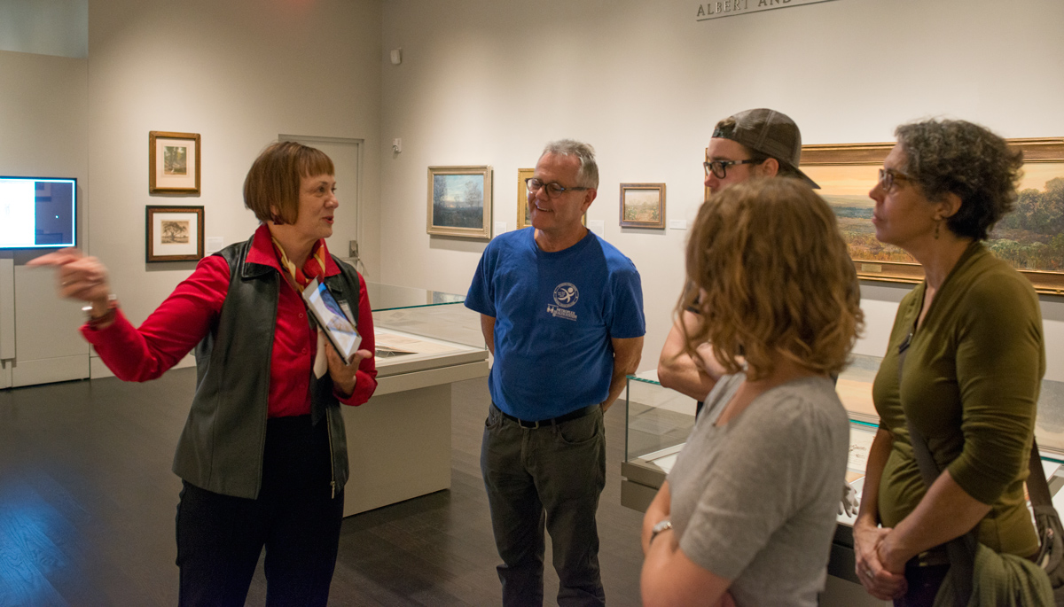 "Pat Clayton leads a tour of the exhibition ""Frank Reaugh: Landscapes of Texas and the American West."" Photo by Pete Smith."