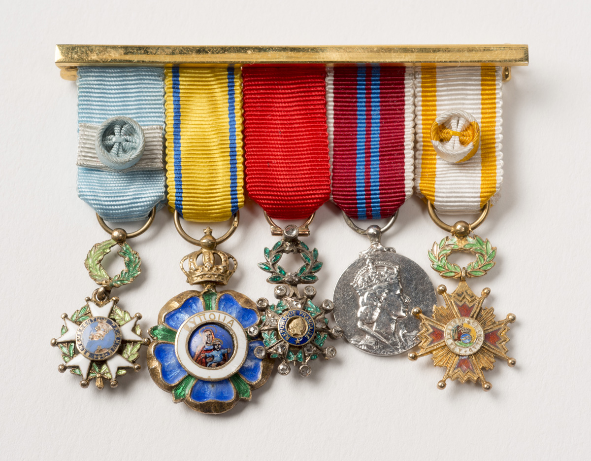 Fleur Cowles's pin with miniature medal reproductions. Photo by Pete Smith.