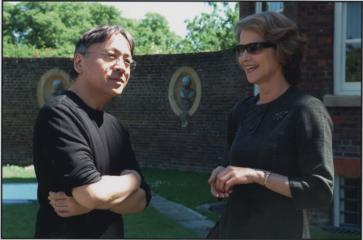 On set at Ham House with English actress Charlotte Rampling, who played Miss Emily in the film adaptation of Ishiguro's novel Never Let Me Go, June 2009. Ham House has been used in many period films and its exterior was used to portray the novel's Hailsham Boarding School.