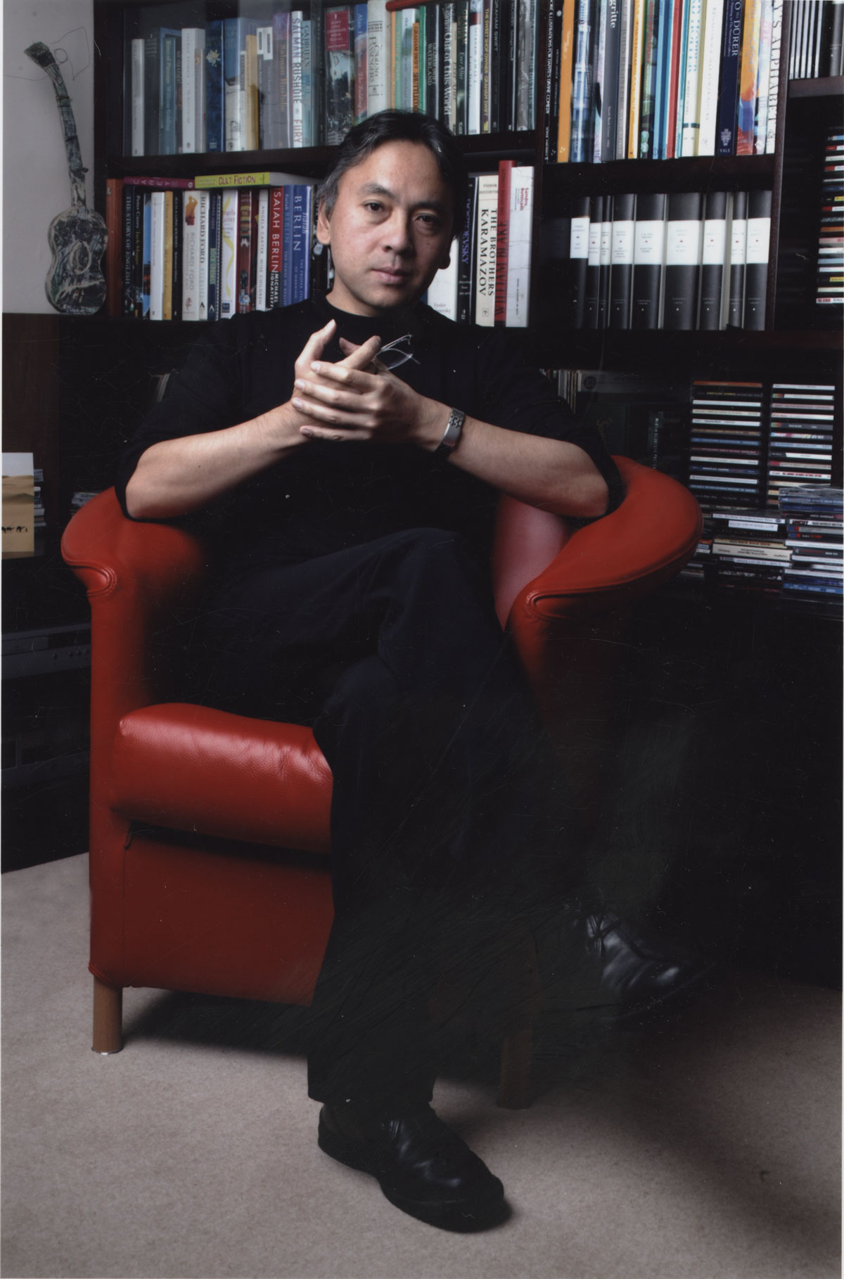 A rare photo of Kazuo Ishiguro not wearing his eyeglasses at his home in London, 2009. Photo by Isabelle Boccon-Gibod.