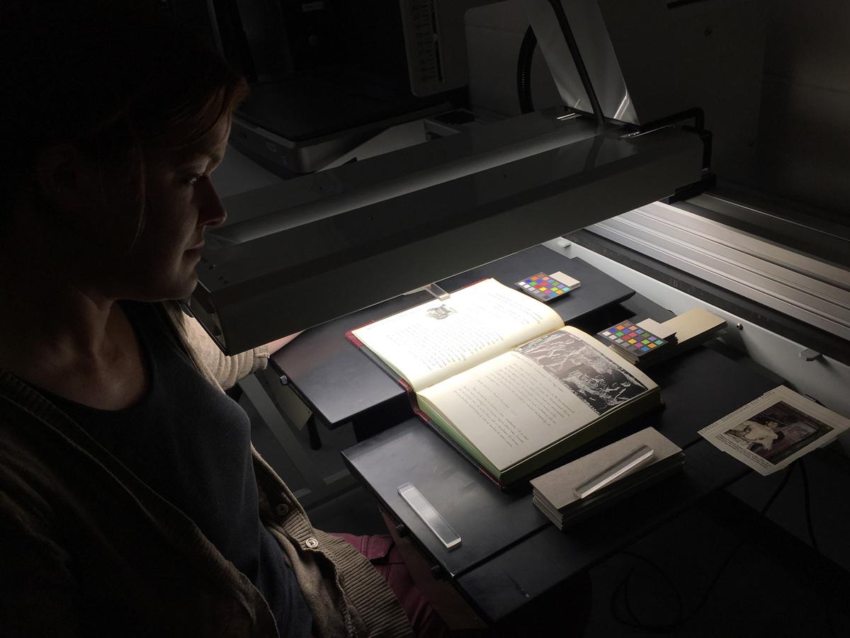 Scanning Technician Anne Merkle scans a Guy Davenport journal. Photo by Alan Van Dyke.