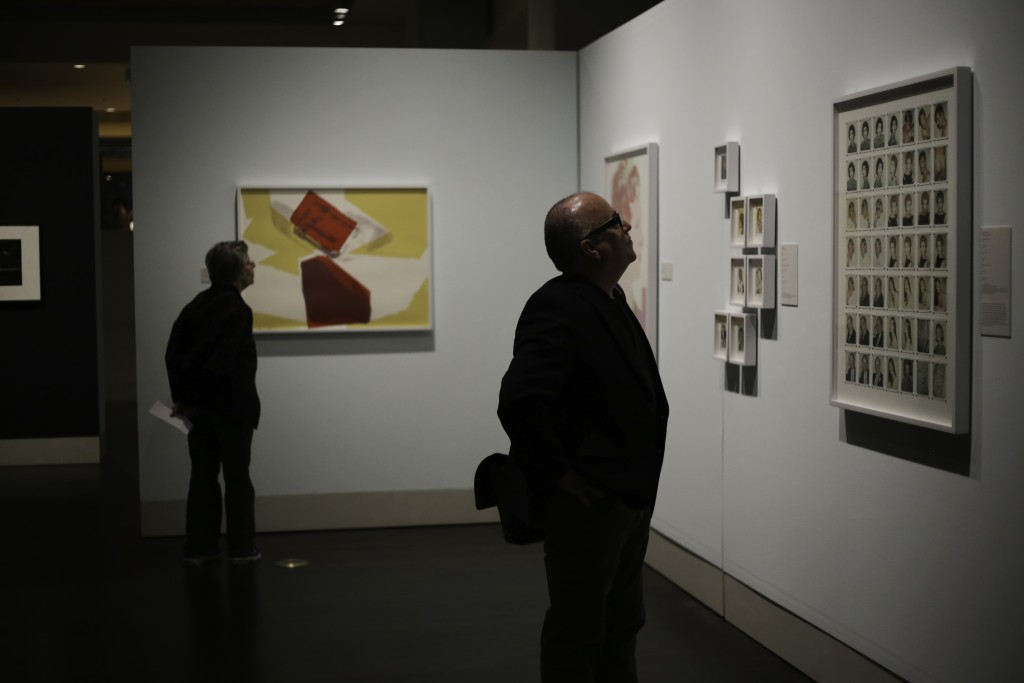 An exhibition visitor views the Andy Warhol photographs.