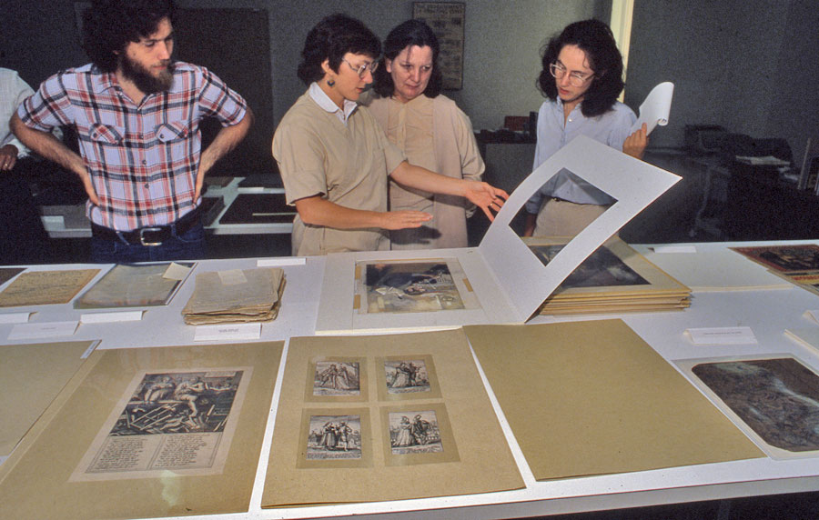 Jane Boyd (center) showing a type of mat housing to a workshop. To Boyd's right is Patricia Hendricks, former staff member of what is now the Blanton Museum of Art. Undated; photographer unknown.