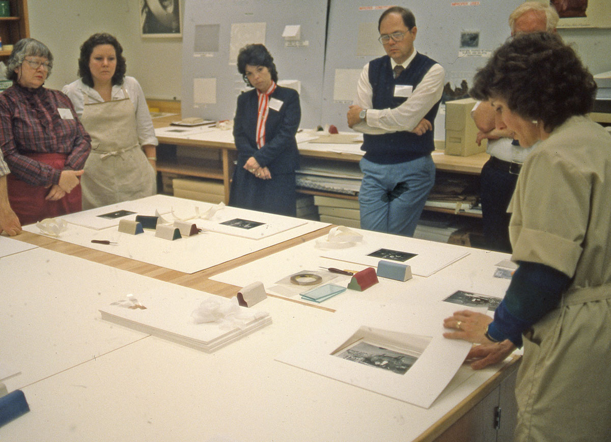 Jane Boyd teaching matting and housing to a class. Undated; unknown photographer.