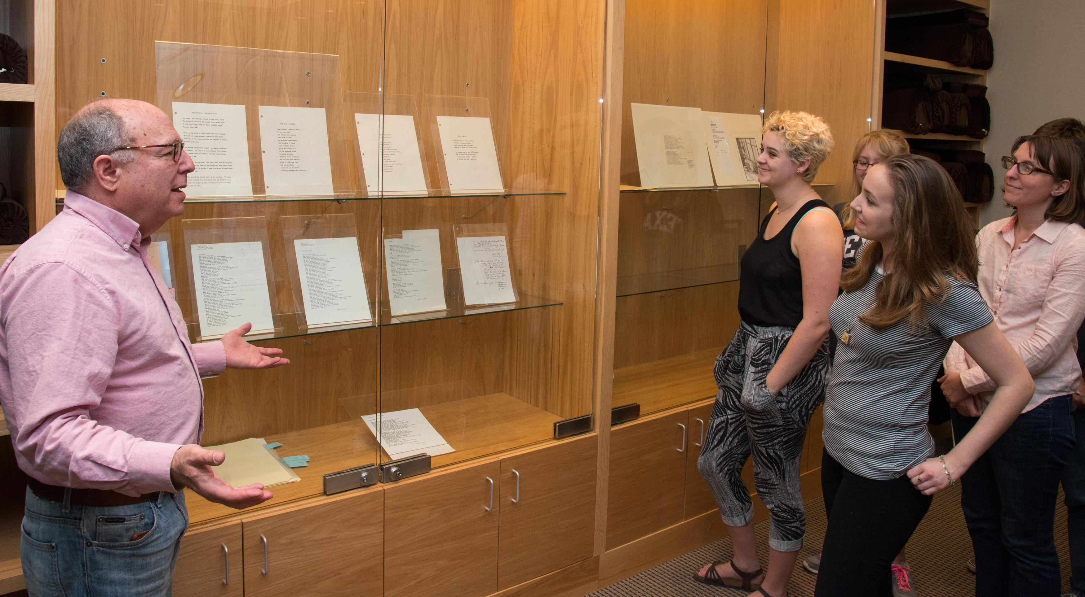 Students observe Ransom Center materials under the guidance of Dr. Robert Abzug.