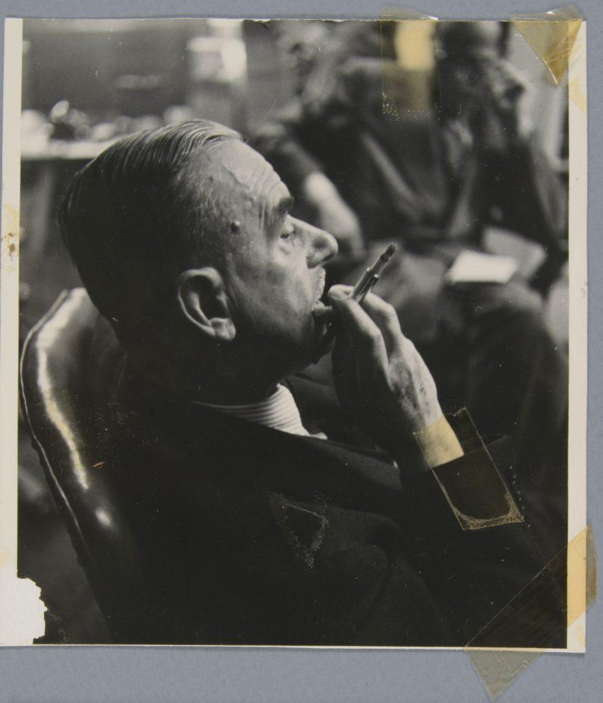 Before treatment—Front with tape residues. Elliott Erwitt (American, b. France 1928), New York, New York [Thomas Mann], 1950. Gelatin silver print, 13.5 x 12.5 cm. Alfred A. Knopf, Inc. Records, Harry Ransom Center. © Elliott Erwitt / Magnum Photos