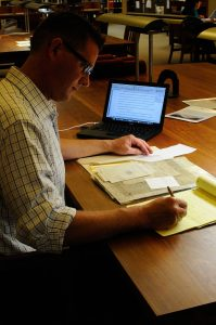 Fellow John Pipkin works with the John Herschel papers in the Reading Room at the Harry Ransom Center. Photo by Anthony Maddaloni.