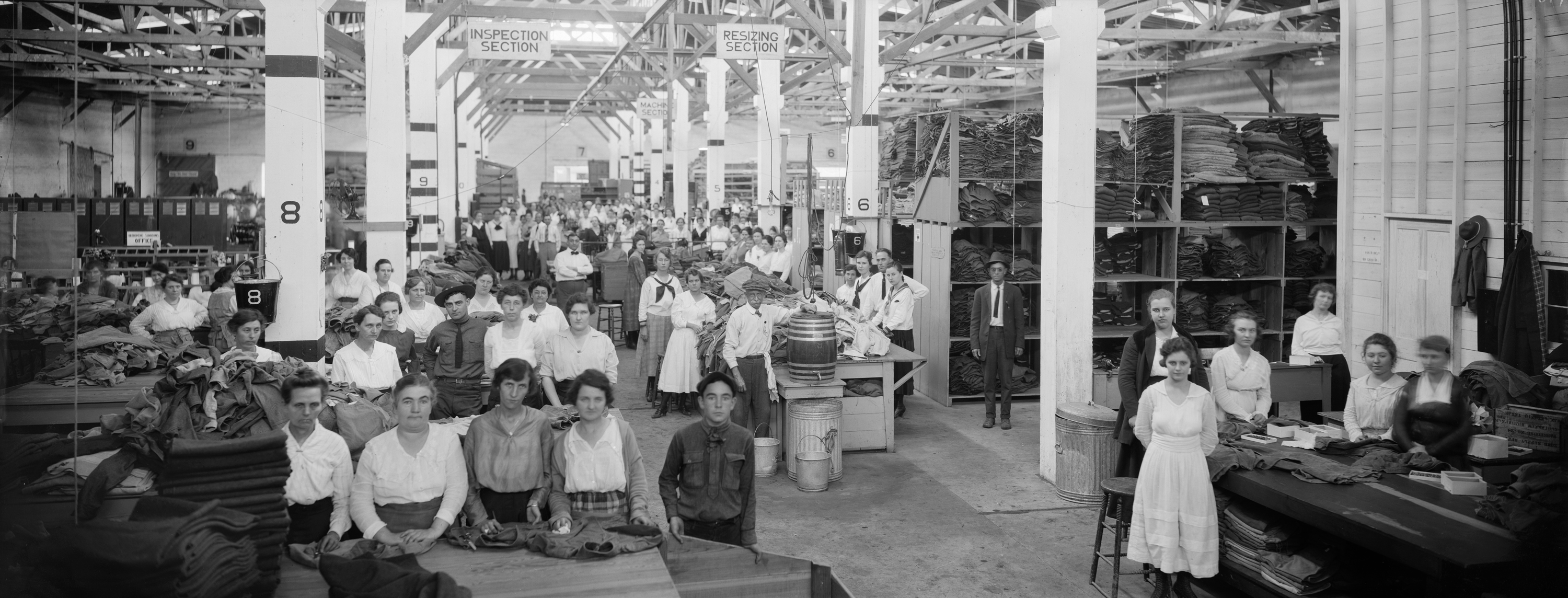 Attributed to C. A. Stead (American, 1870-1932), QMC Personnel Working on Army Clothing at a Supply Depot, ca. 1919. Digital positive from nitrate negative, 20 x 50.4 cm. E. O. Goldbeck Papers and Photography Collection, 967:0068:0887