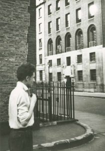 Peter O'Toole approaching the Royal Academy of Dramatic Art, ca. 1952.