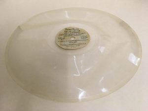A warped dictation disc.