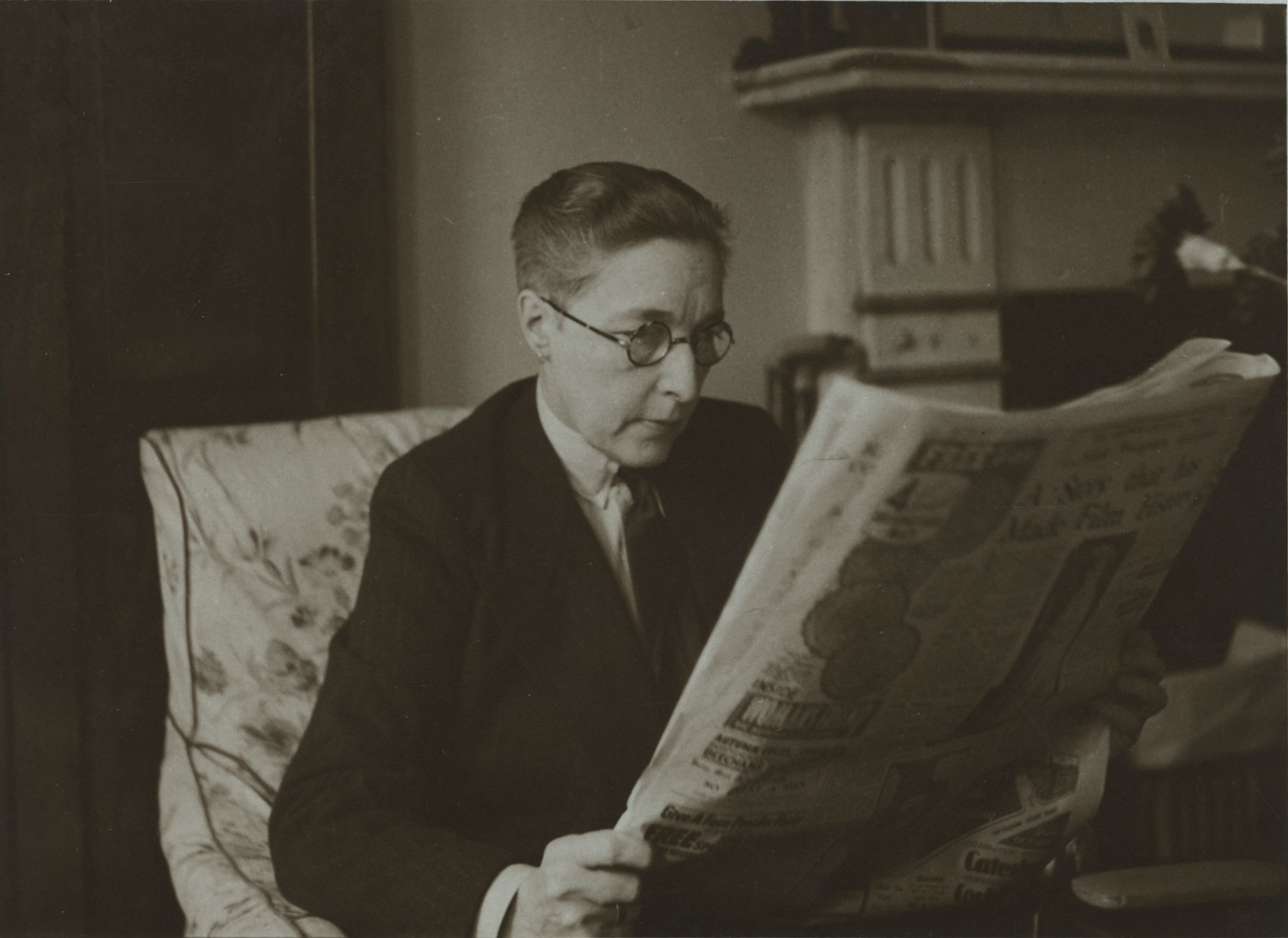 Radclyffe Hall reading a newspaper. From the Radclyffe Hall Literary File at the Harry Ransom Center. Undated.