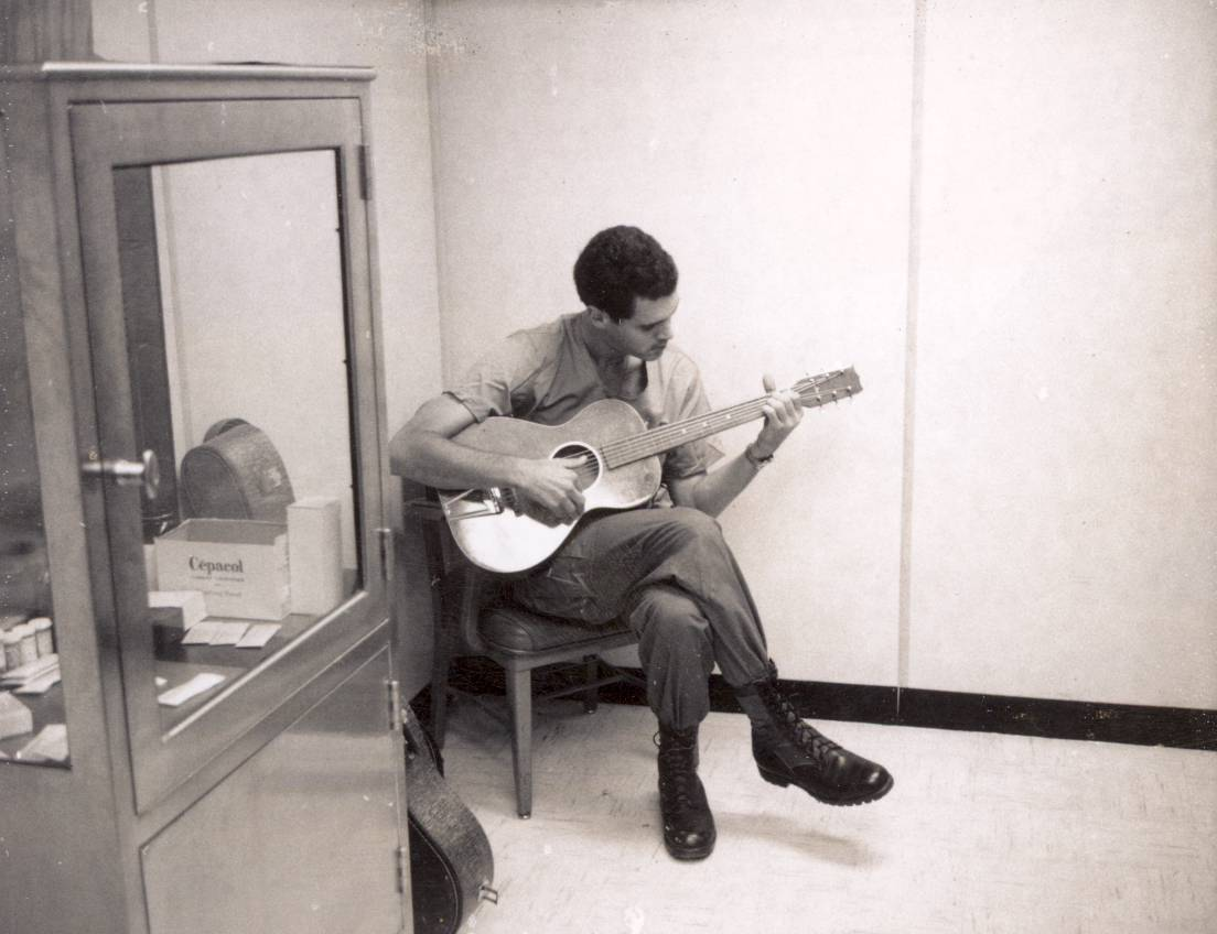 Dean Echenberg with guitar during his service in Vietnam