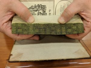 The Ransom Center's copy of Edmond Hoyle's treatise on Whist decorated with a fore-edge painting of playing cards.