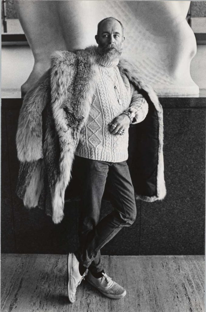Gorey near one of the Nadelman sculptures on the promenade at the New York STate Theater, 1973. (Photograph by Bruce Chernin. Image provided by the Alpern Collection, Rare Book & Manuscript Library, Columbia University.)