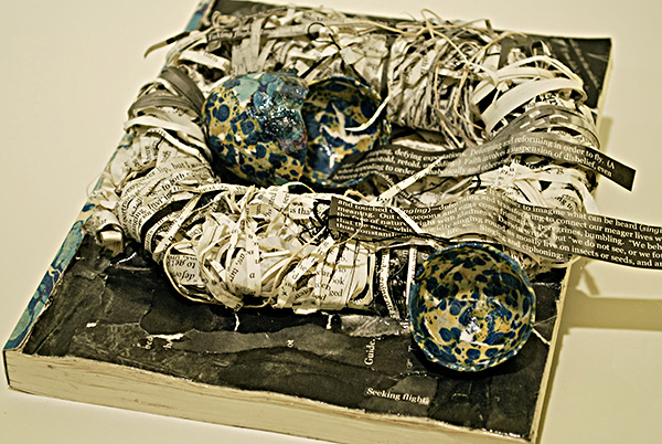Another deformance of Henderson's Galerie de Difformité, nested as birds' eggs by Kat O'Hara and exhibited in Kenyon College's Greenslade Special Collections & Archives.