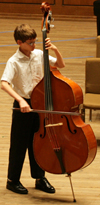 Student playing a bass